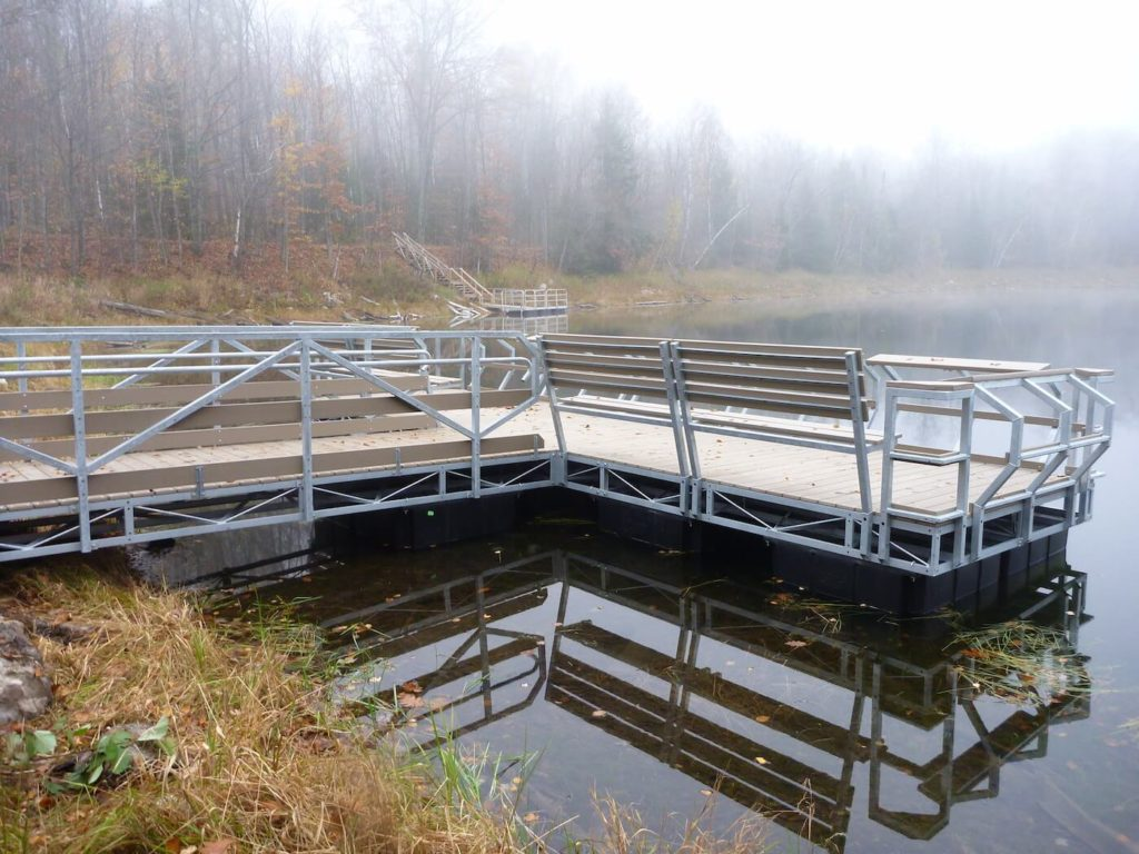 The handicap accessible fishing pier and secondary pier at Bug Lake are excellent examples of the projects that the program has administered to encourage community access to the FCP waters.